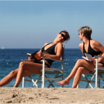 Women relaxing in beach chairs on the beach