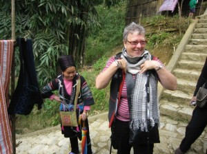 Rosemary tries on hmong scarf