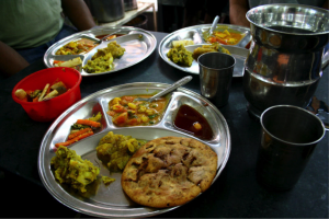 "Old Delhi – Chandni Chowk…""Food to die for""…Paranthe Wali Gali …Classic Stuffed Parantha Thali with chutney, pickles and vegetable dish…yum…yummy!"